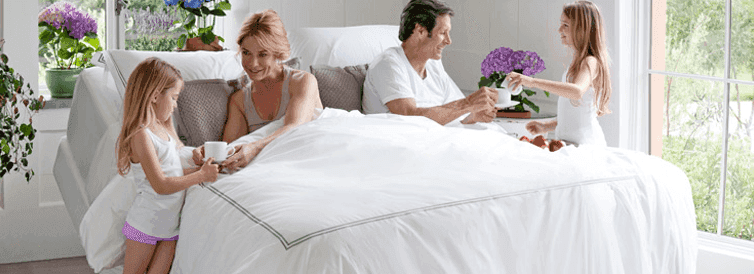 family in adjustable bed